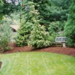 Does mulching benefit garden beds?
