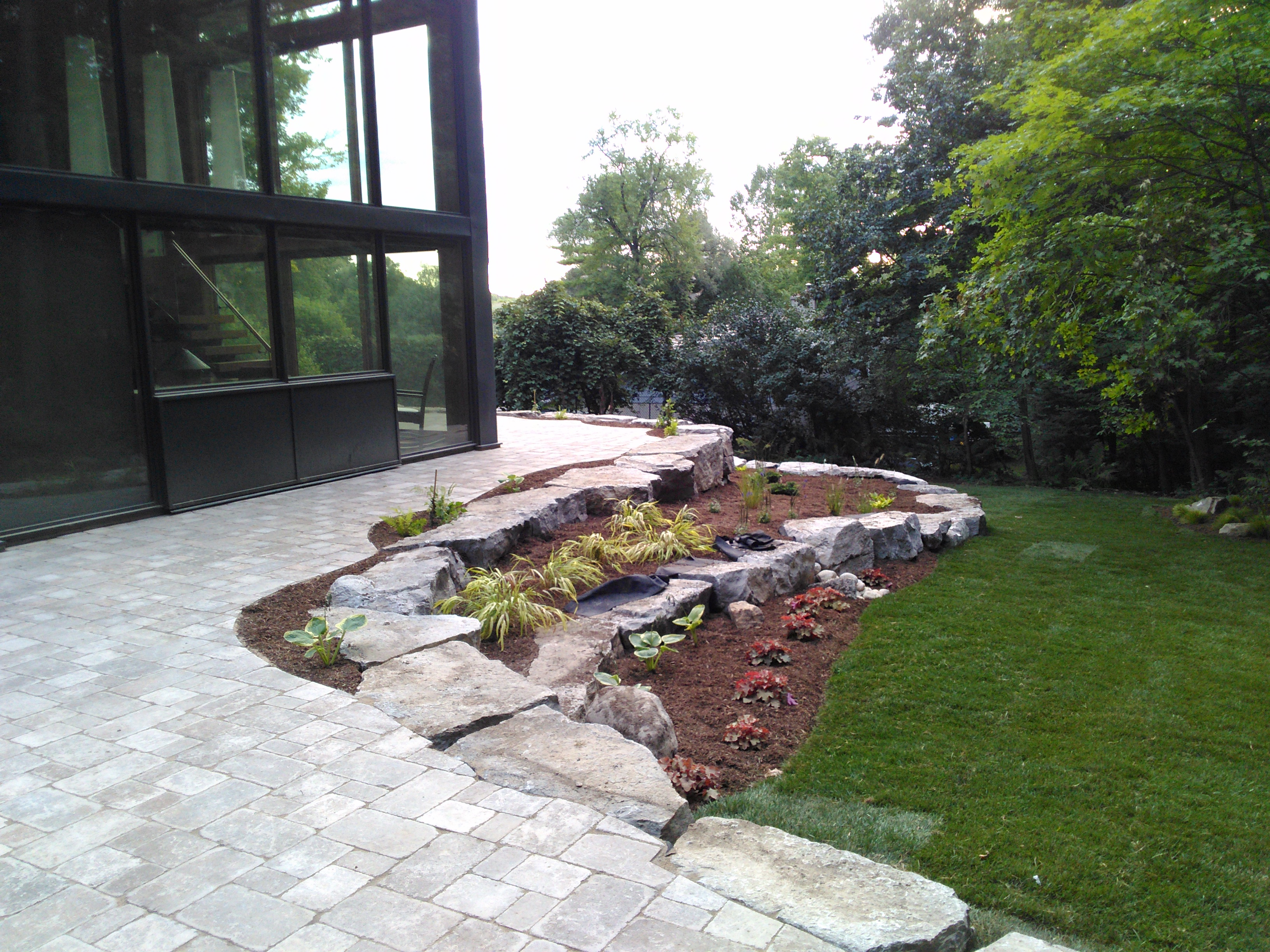 Backyard interlock patio and retaining wall