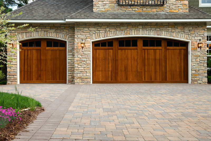 Pavers, custom doors, and stone on upscale home.
